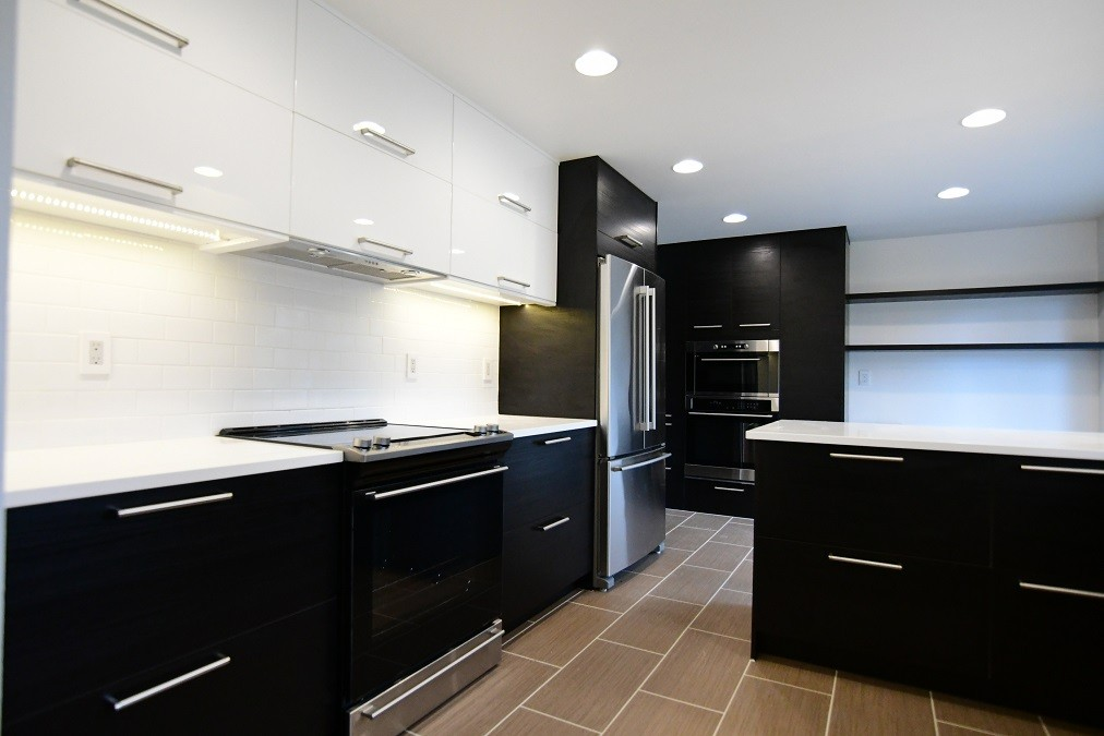 Contract remodel in Portland, OR featuring black and white IKEA kitchen cabinets