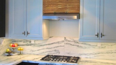 Kitchen remodel with marble counters and custom IKEA cabinets