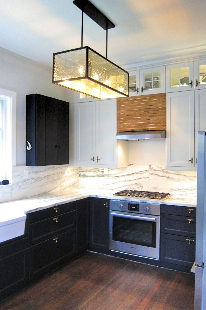 Kitchen remodel with black & white cabinetry and industrial chandelier