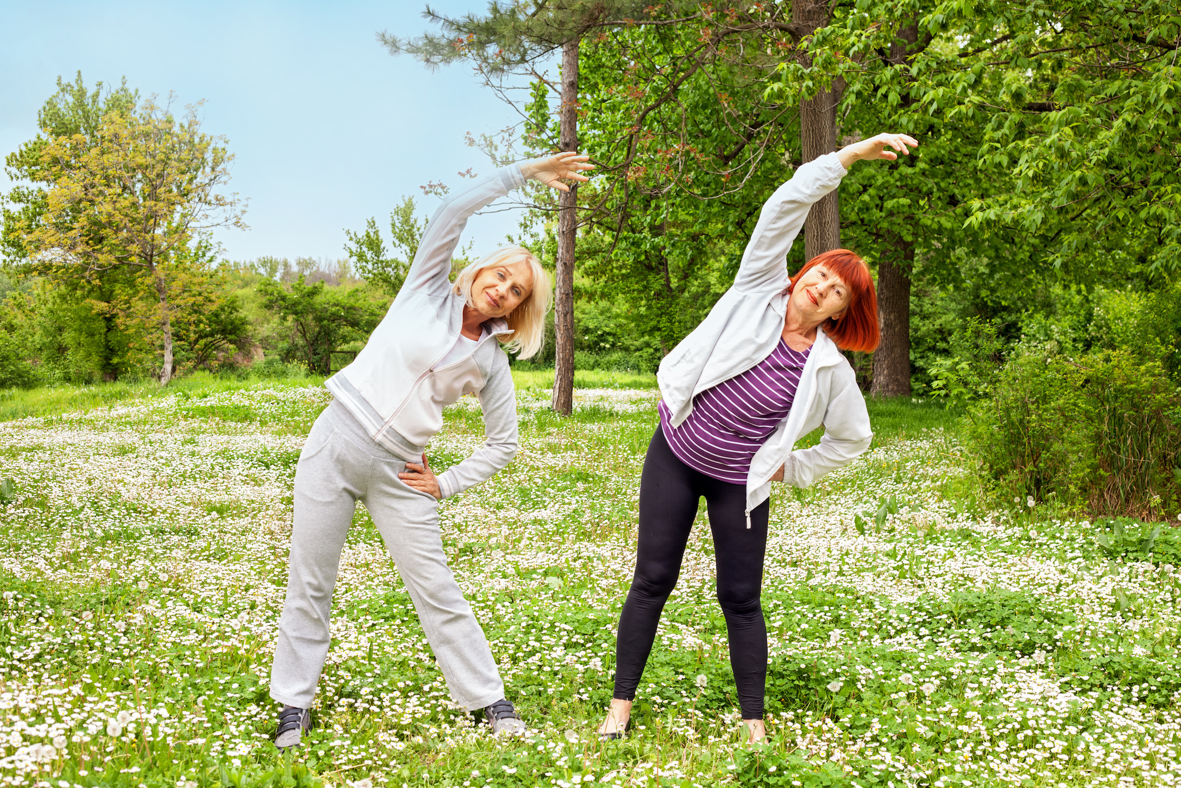 Senior Women (50s And 60s) Stretching Outdoors