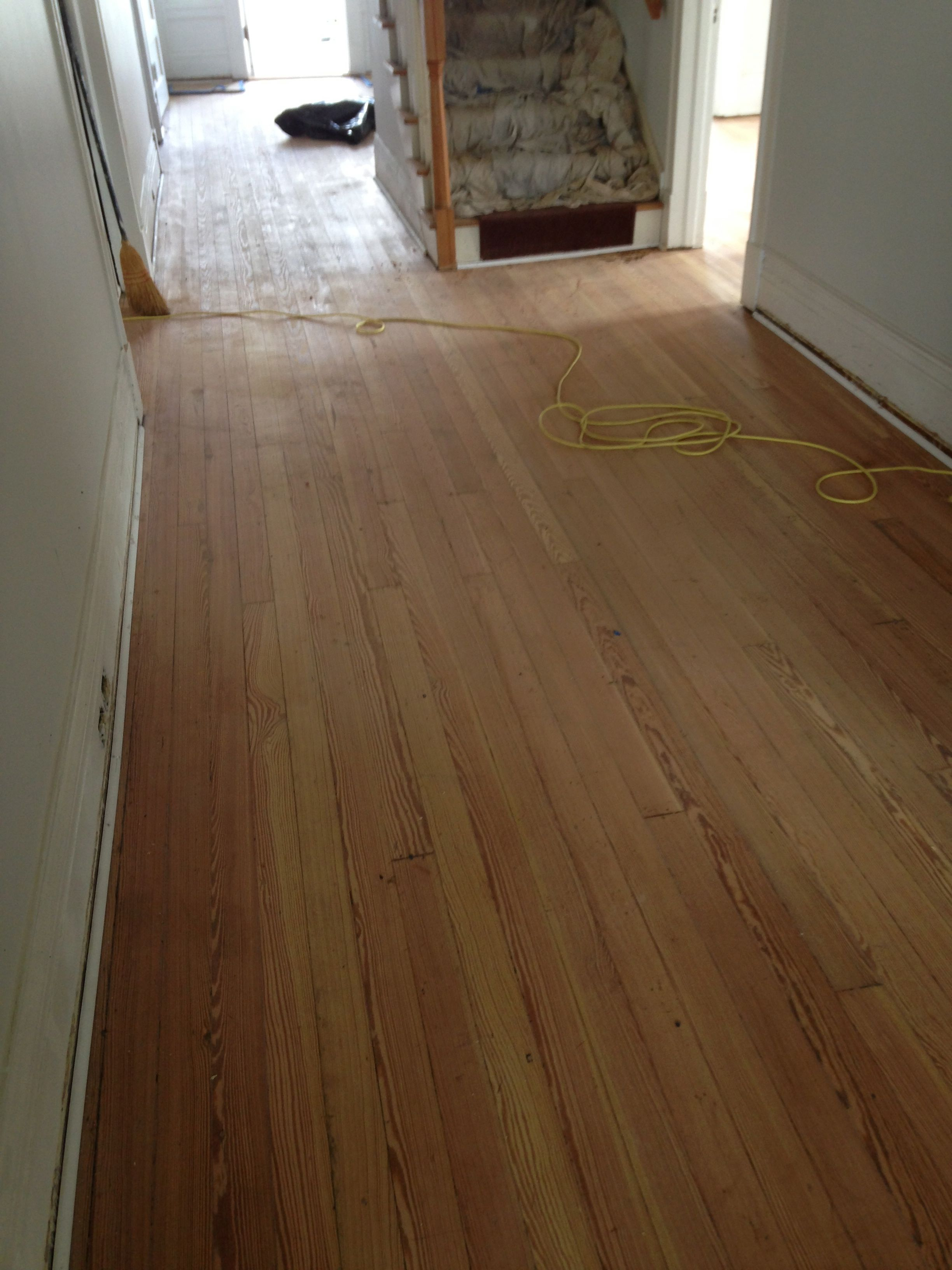 A picture of completely sanded hardwood previously covered in tar.