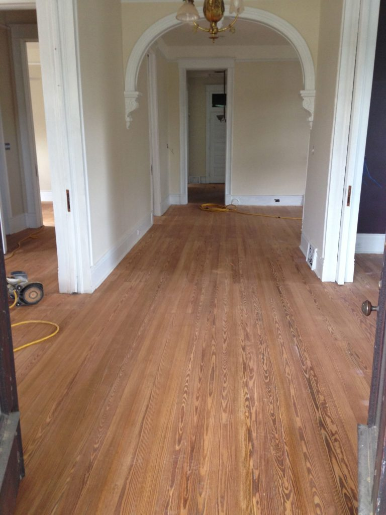 Sanded and cleaned hardwood floors.