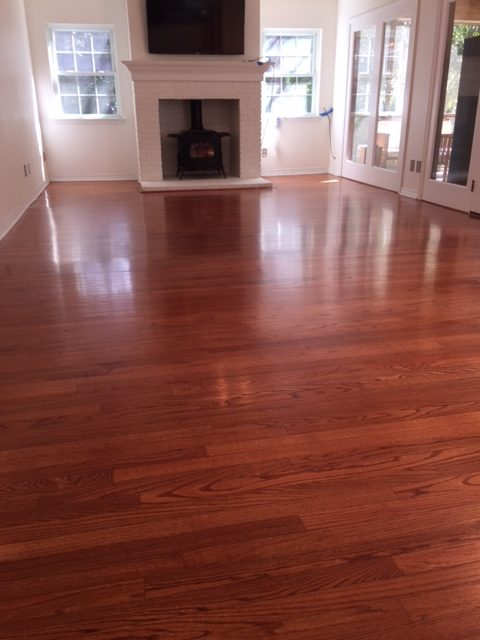 Photo of refinished new flooring after tile removal. Custom matched to existing flooring.