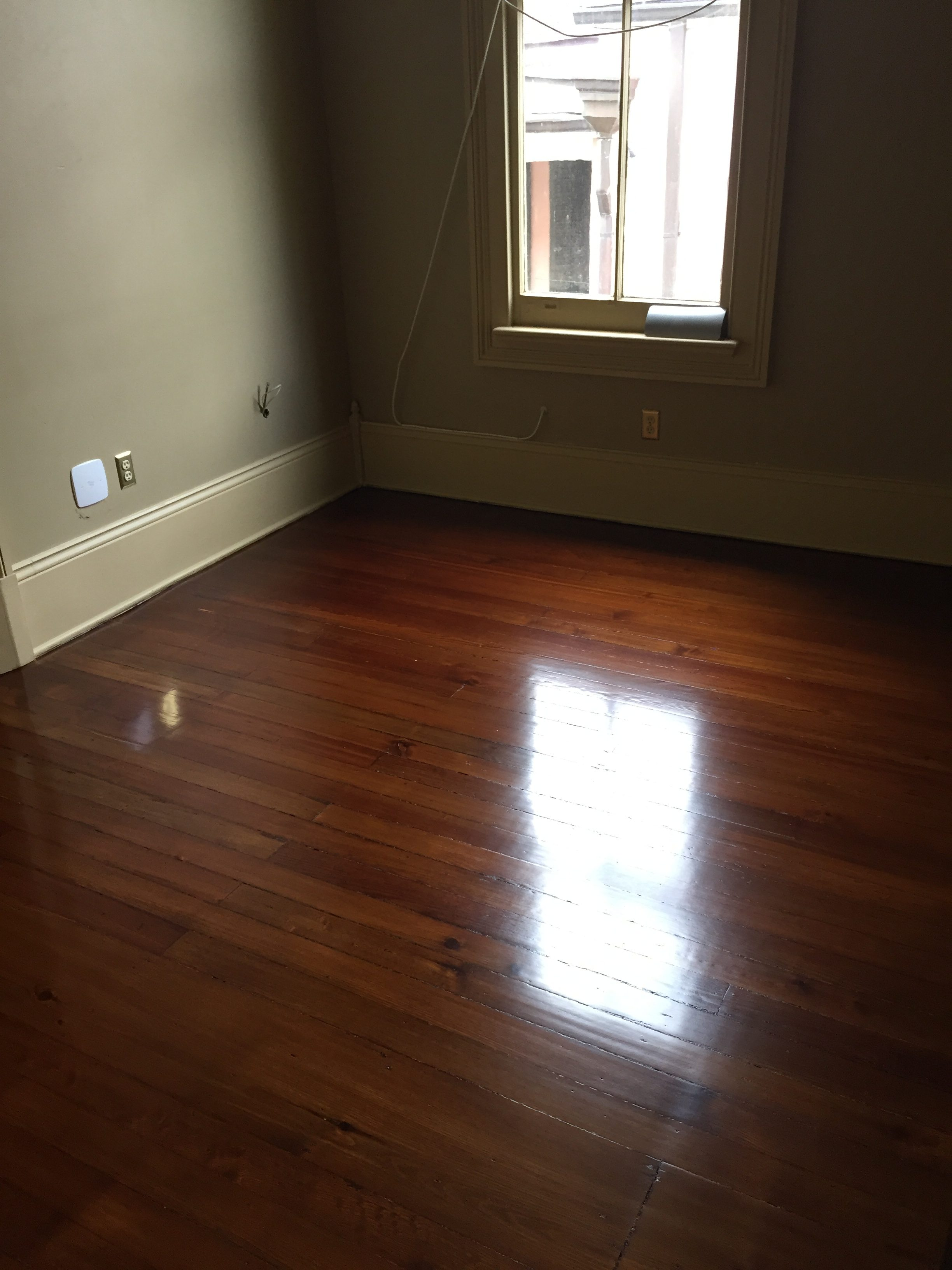 This is a bedroom of refinished hardwood pine floors.