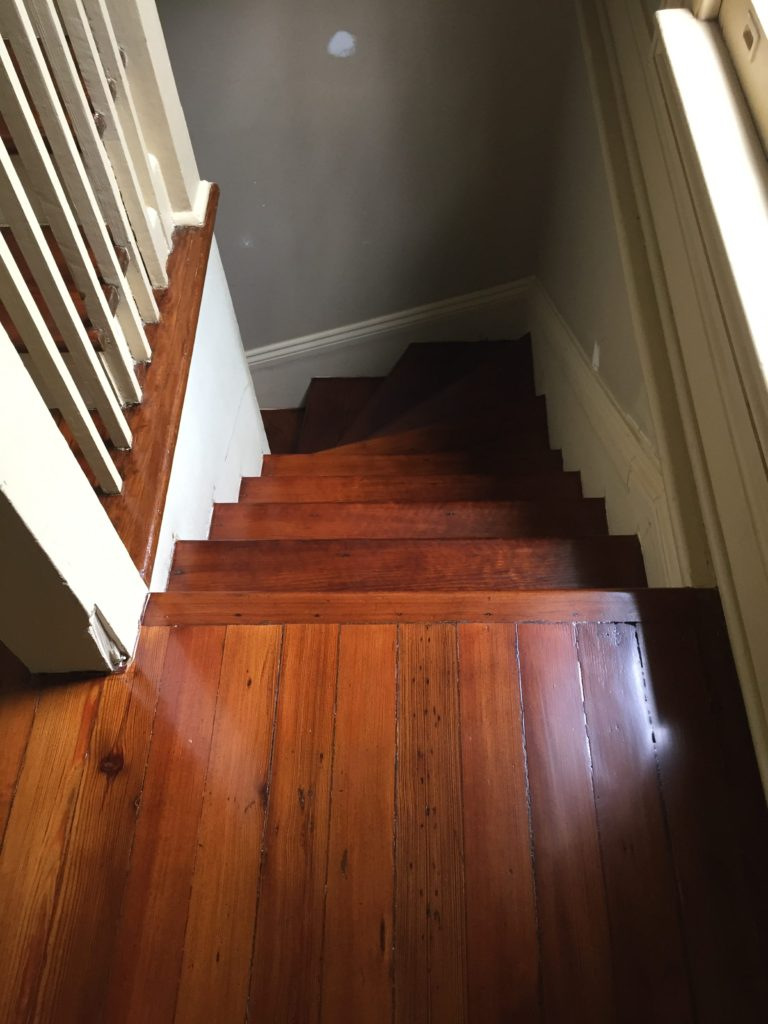 This is a staircase of refinished hardwood pine floors.