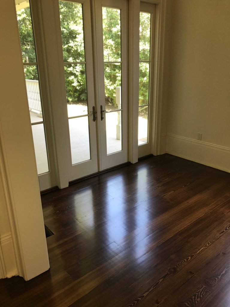 Pictured is a room with dark stained red pine hardwood flooring.