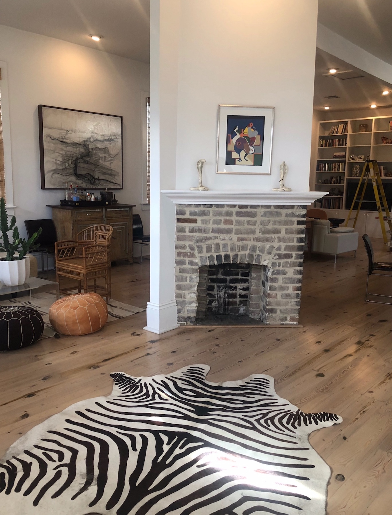 A photo of a living room with refinished hardwood flooring. It is bleached light with dark knots.