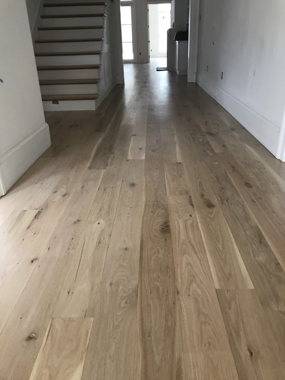 This is a photo of white oak flooring with a satin finish. It has a weather washed appearance.