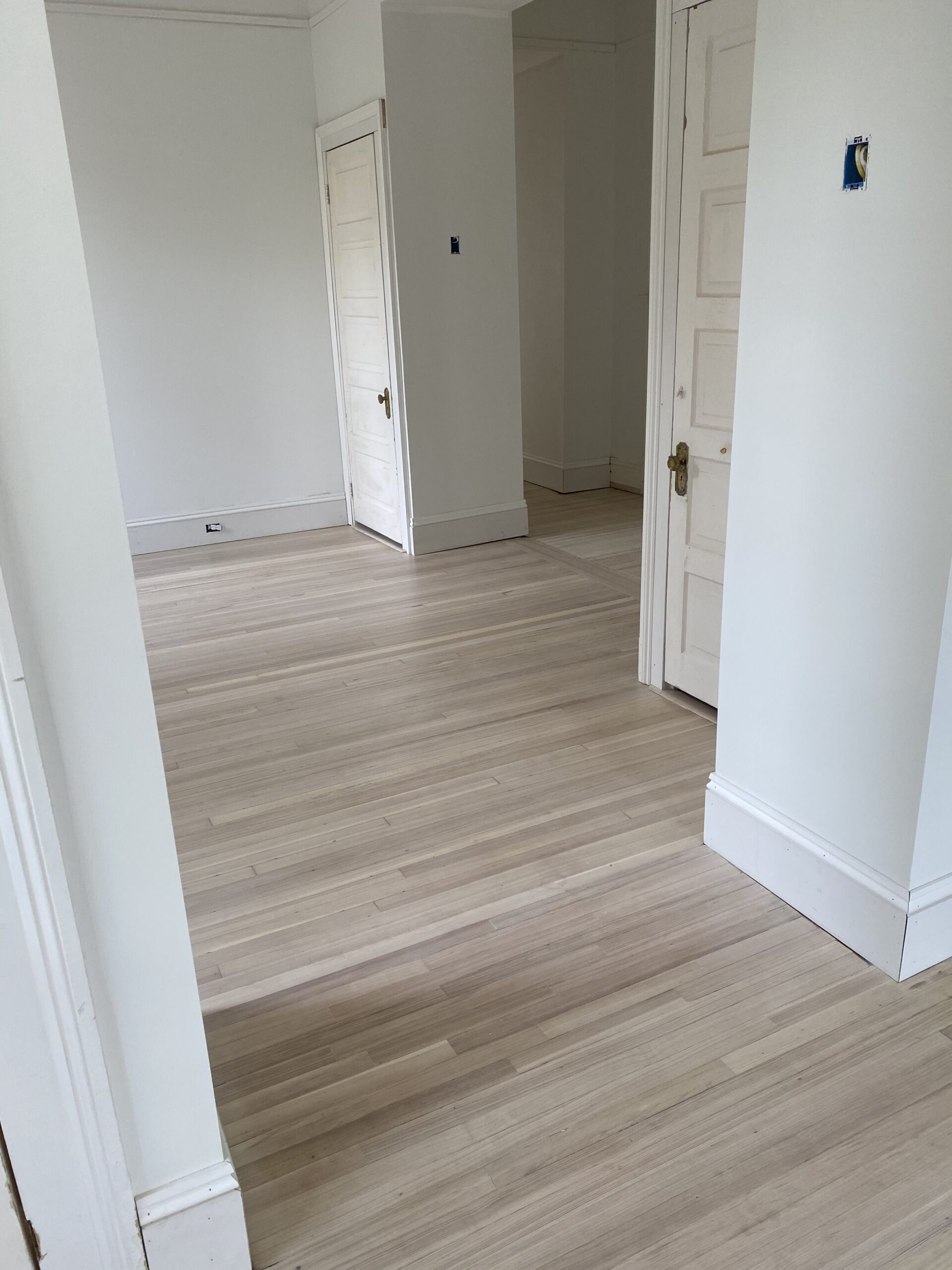 After photo of bleached hardwood with a white wash finish