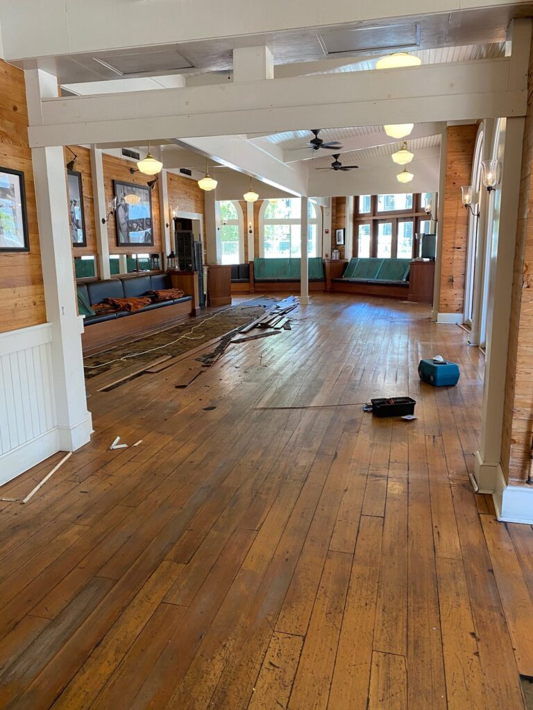 Existing hardwood flooring in a restaurant to be demoed and replaced with new hardwood flooring.