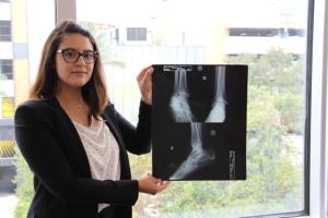 Attorney Katrina holding up x-ray photo