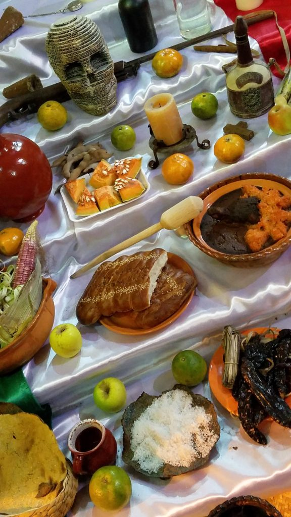 Different foods on an altar for Day of the Dead