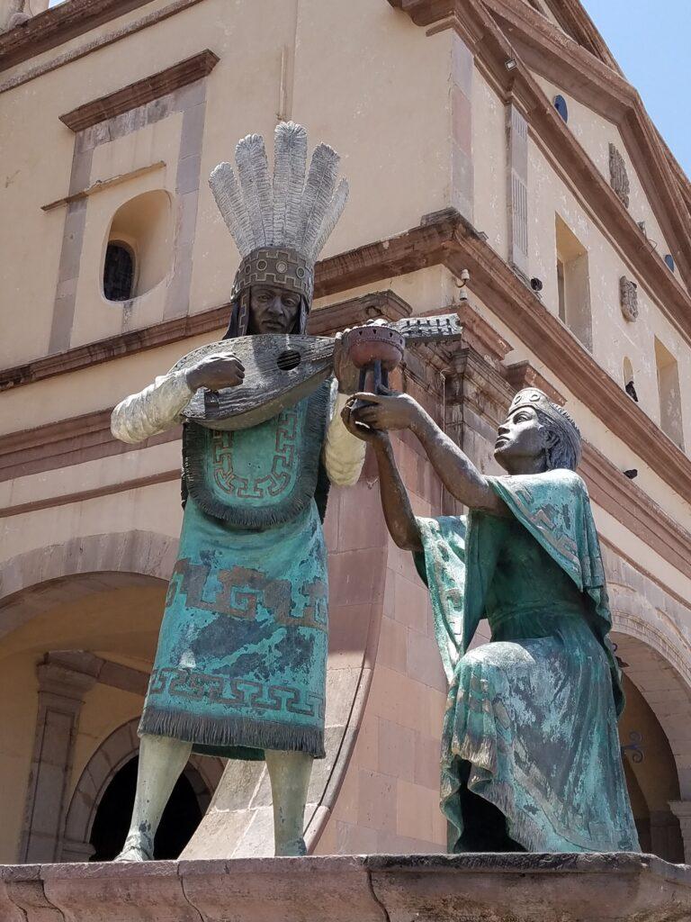 Otomi Indian statue outside Templo de la Santa Cruz, Queretaro