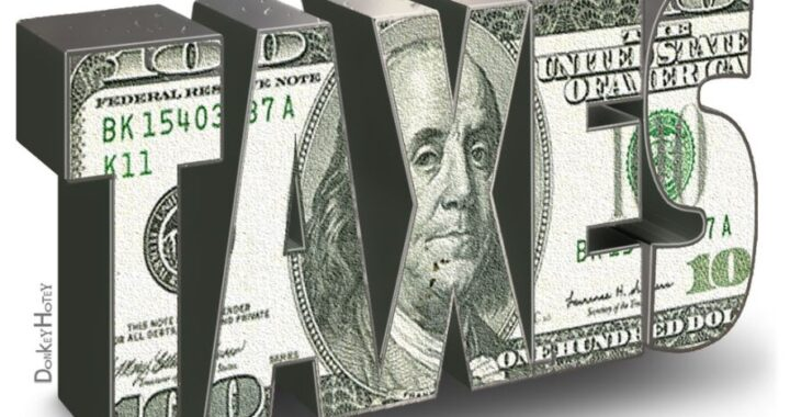 The word taxes with dollar bill background