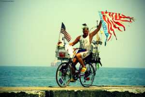 man on bike with flags