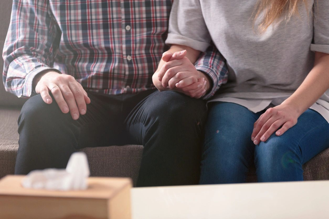 Couple holding hands at counseling