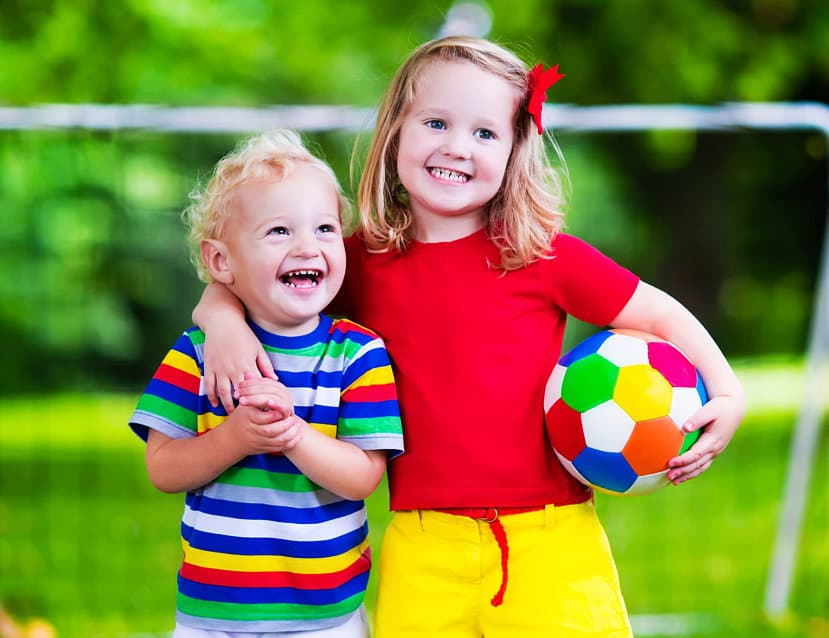 couple of kids playing soccer