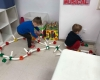 couple of boys playing with plumbing game