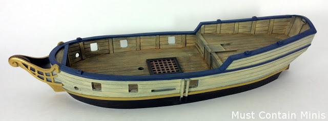 A Painted Blood and Plunder Sloop - or at least the hull of the ship. Model by Firelock Games.