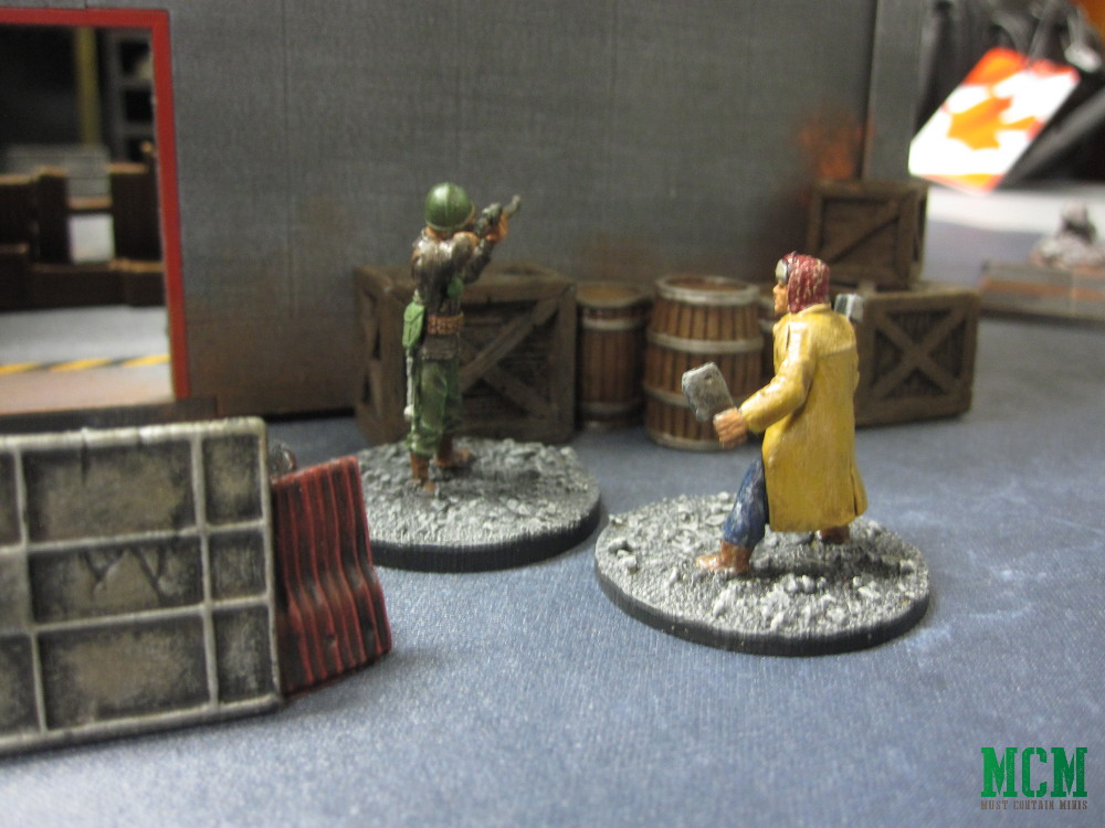 28mm Apocalypse survivors move towards a building