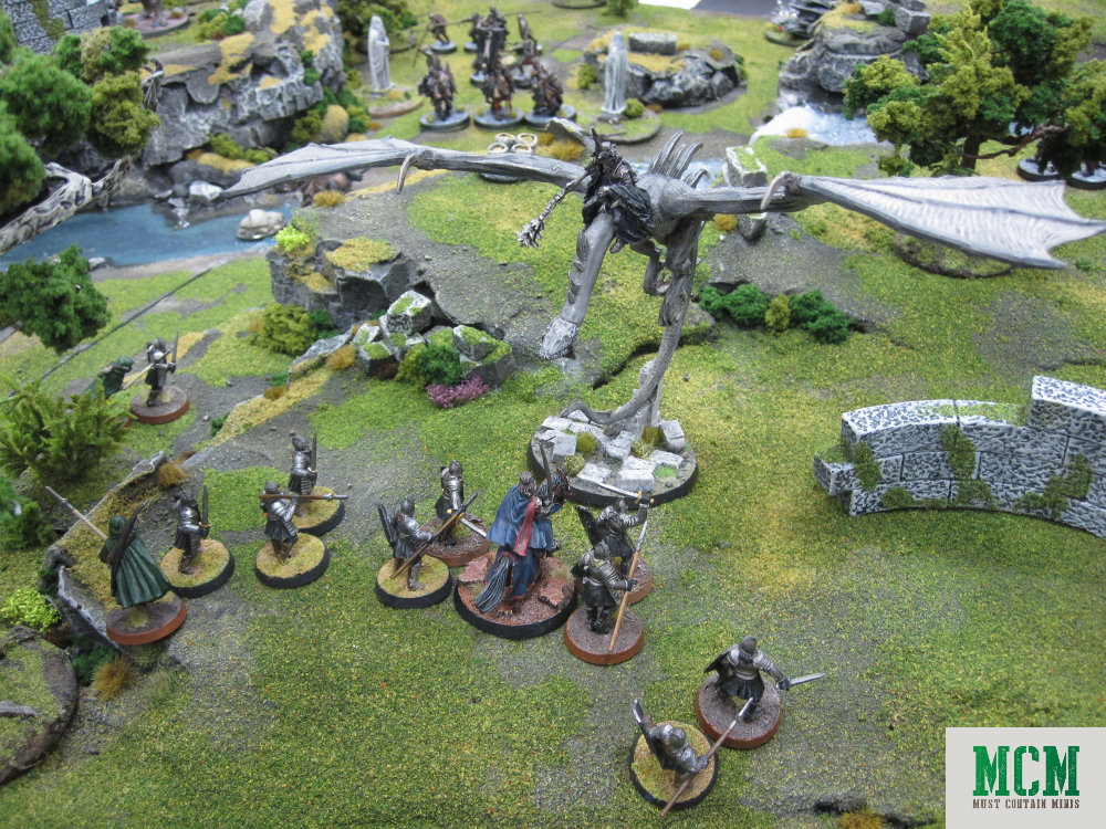Ringwraith™ on a Fell Beast takes on many soldiers at once. 28mm tabletop gaming.