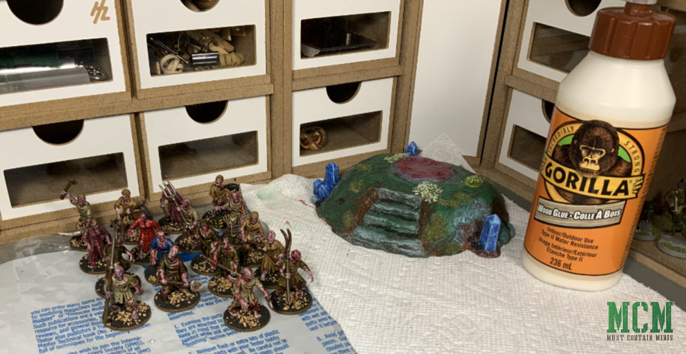 On Jacob Stauttener's hobby desk. I use Gorilla Glue Wood Glue to paste my basing materials to my terrain and miniatures.