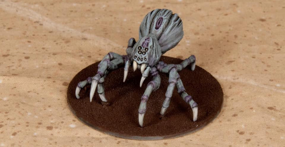 A prototype miniature spider on a 28mm base.