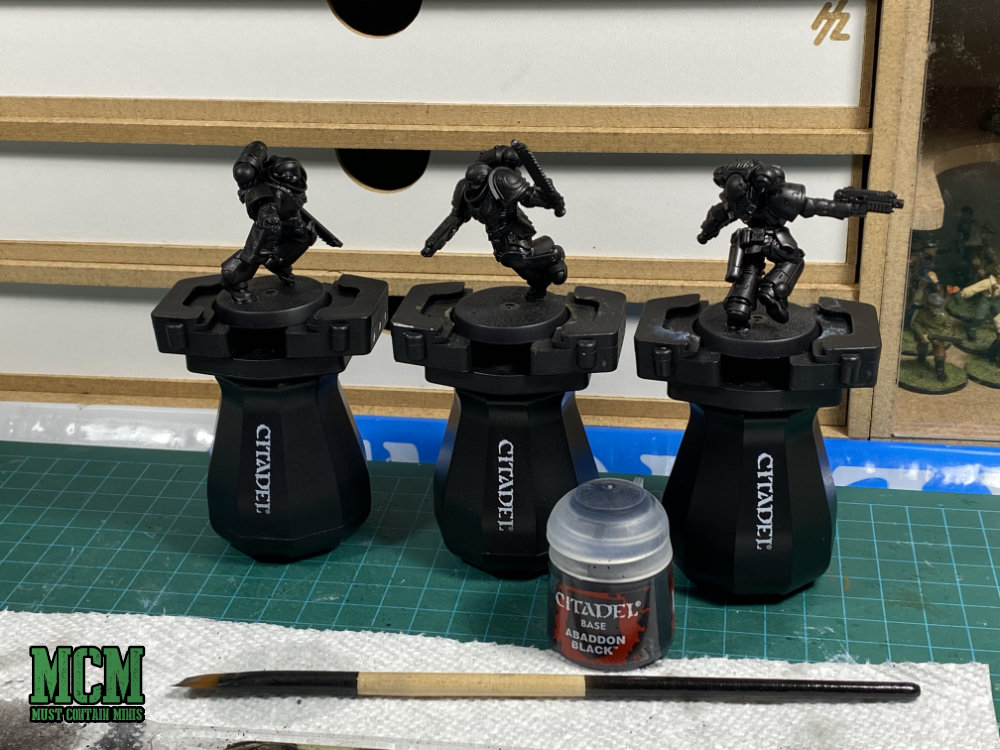 How to Paint Miniatures. Brush on Abaddon Black Citadel Paint if you don't have spray primer. It works just the same.