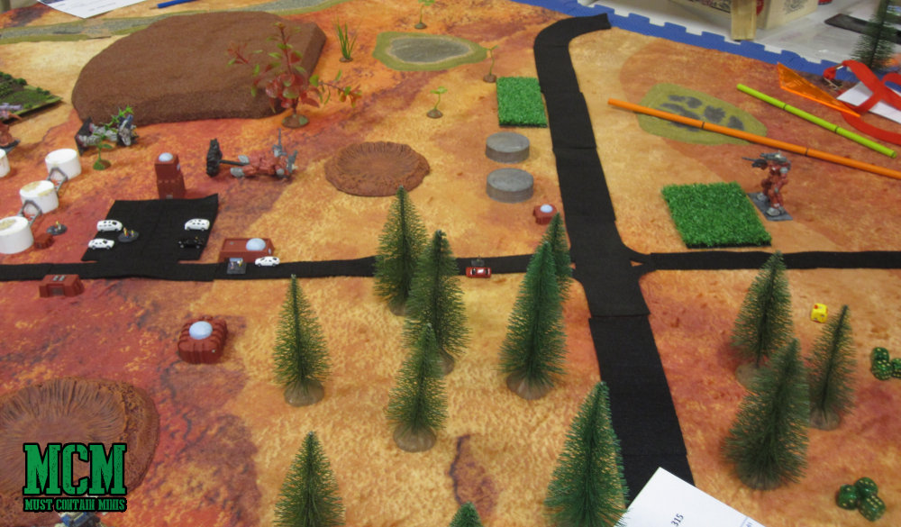 Giant stompy miniatures game in play at broadsword 8