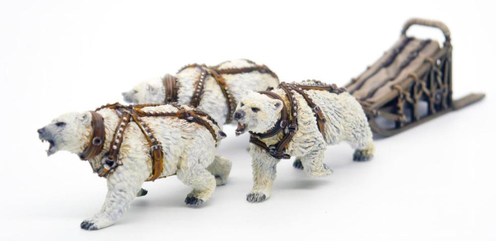 Miniature dog sled pulled by polar bears