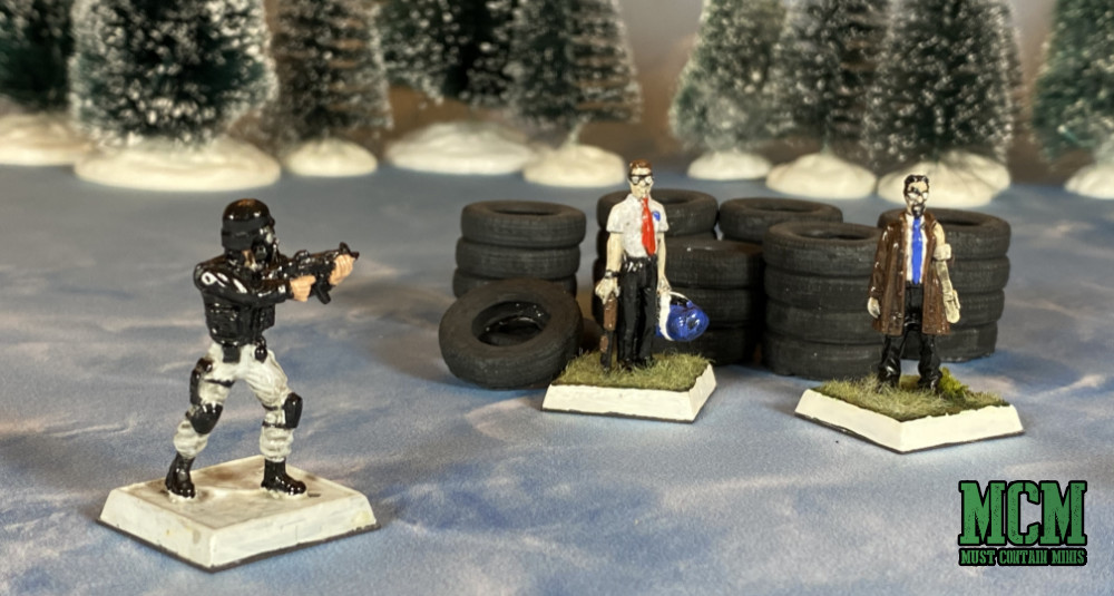 RAFM Miniatures along side Six Squared Studios tires on a Cardboard Dungeon Games.