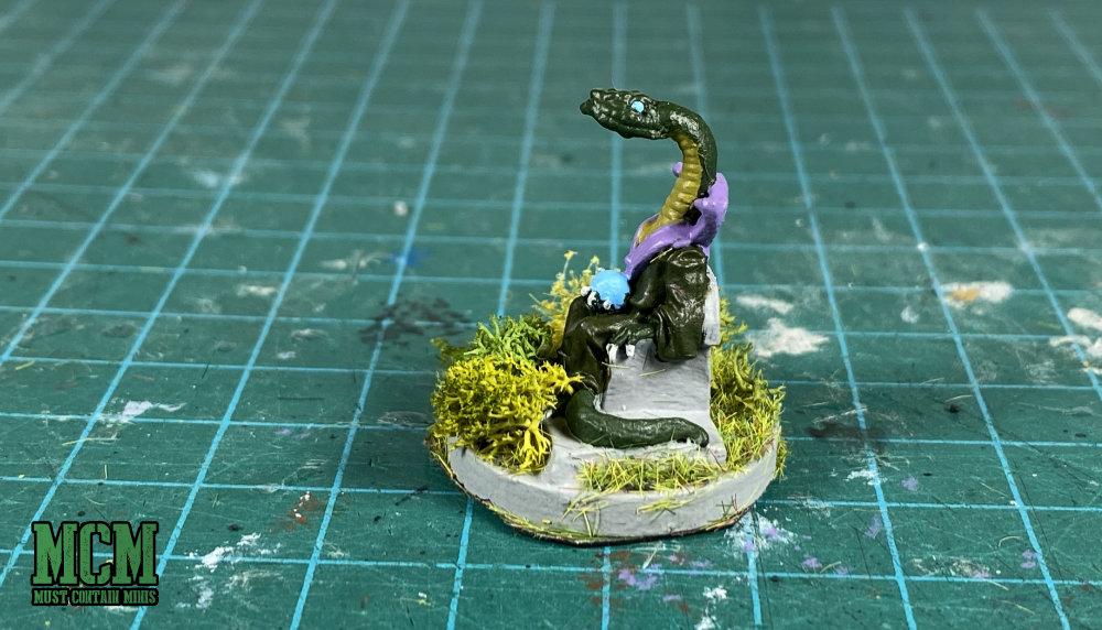 Serpent man wizard or cult leader miniature