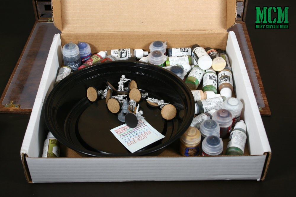 The pizza box method of carrying and storing paints for miniatures.