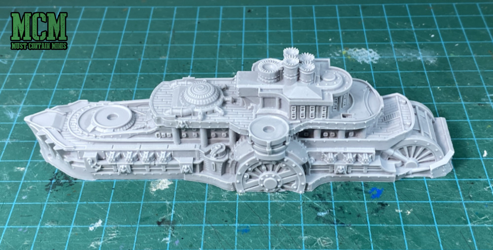 The resin ship before the plastic parts