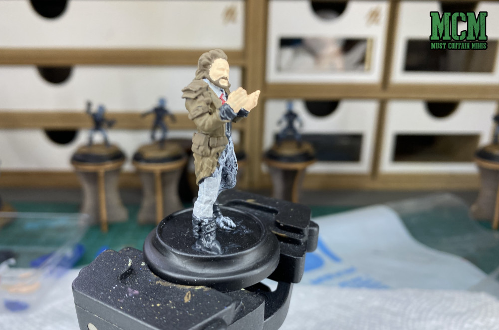 Base coating a miniature of Giorgio from Ancient Aliens