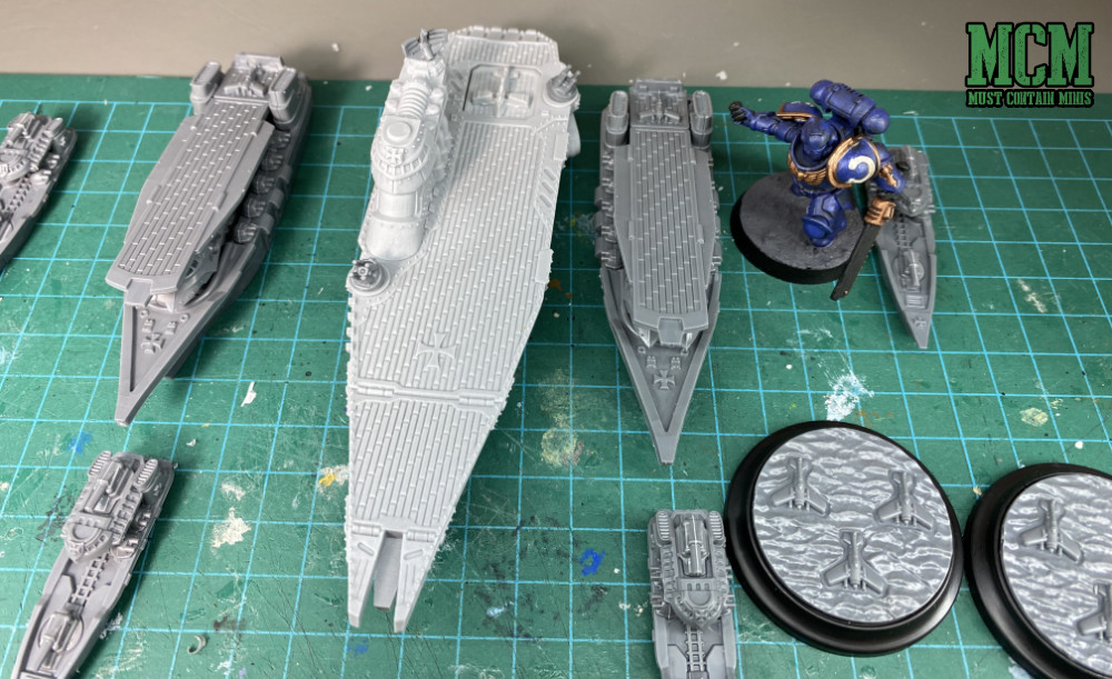 Scale comparison of the Tempelhof Battlefleet vs a Warhammer 40,000 Primarus Space Marine. The ships are so big! Compare the size of the base to the ships.