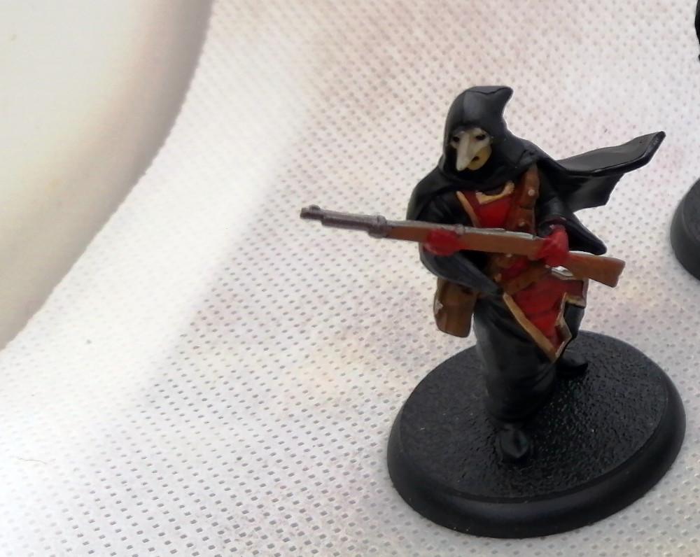 Shadows of Brimstone Painted Miniatures - Painted Crimson Hand Cult member.