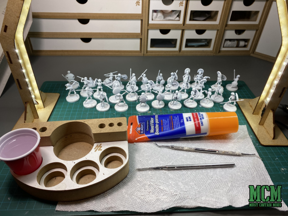 How to Prep Plastic Miniatures for Painting - How to deal with an integrated base - method one - Spackle or wood filler