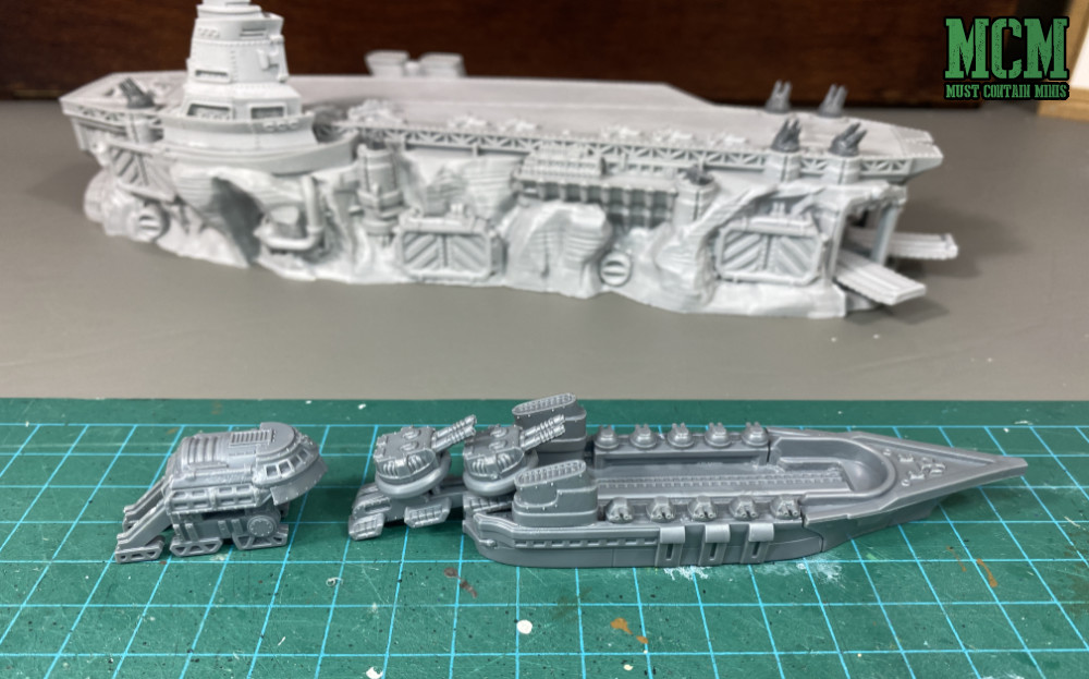Dystopian Wars - trains loading guns onto a ship