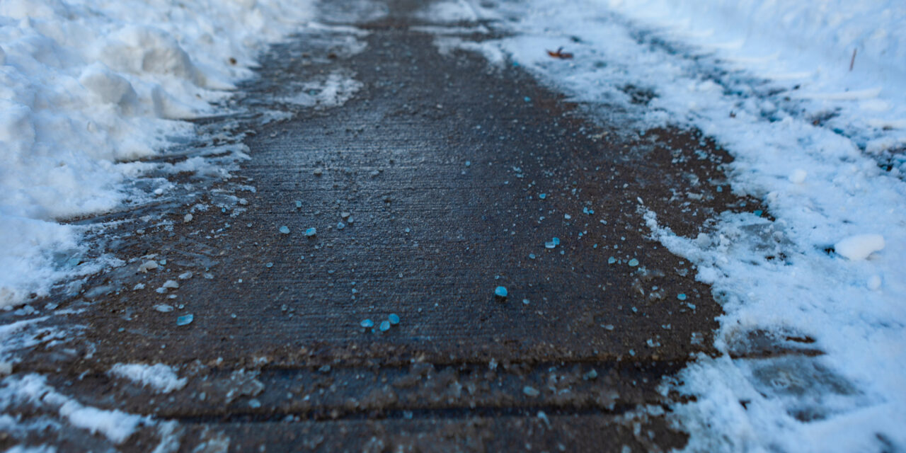 Toronto, CANADA - January 27th, 2019: Canadian blue salt on roads for better melting of ice with liquid magnesium chloride.