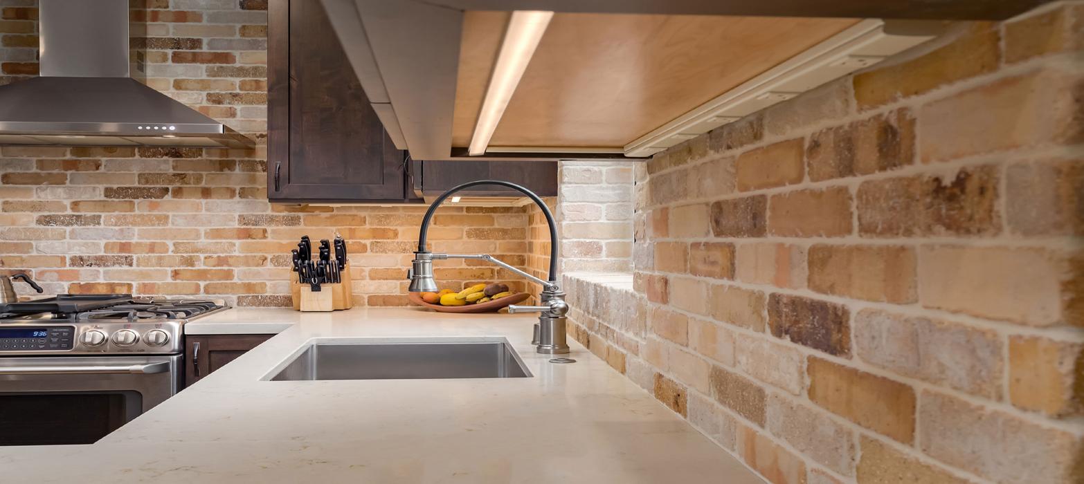 natural-stone-backsplash-in-contemporary-kitchen-talmadge-construction-inc-img_766108b709515c99_14-1562-1-87d08f5