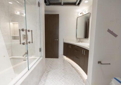 large bathroom vanity and bathtub