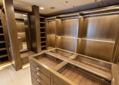 master walk-in closet with vast storage space