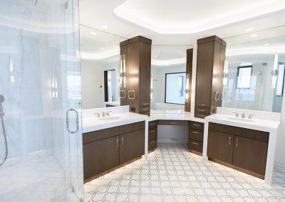 2 bathroom sinks with large vanity mirrors