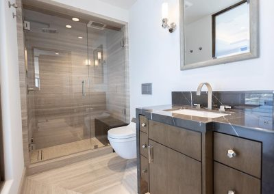 office bathroom with shower and storage