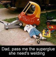 Child repairing his plastic vehicle