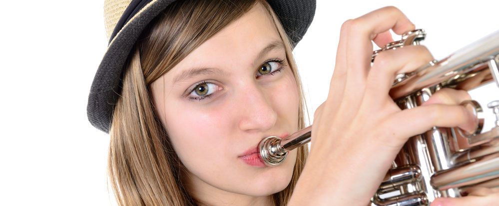 teenager plays the trumpet