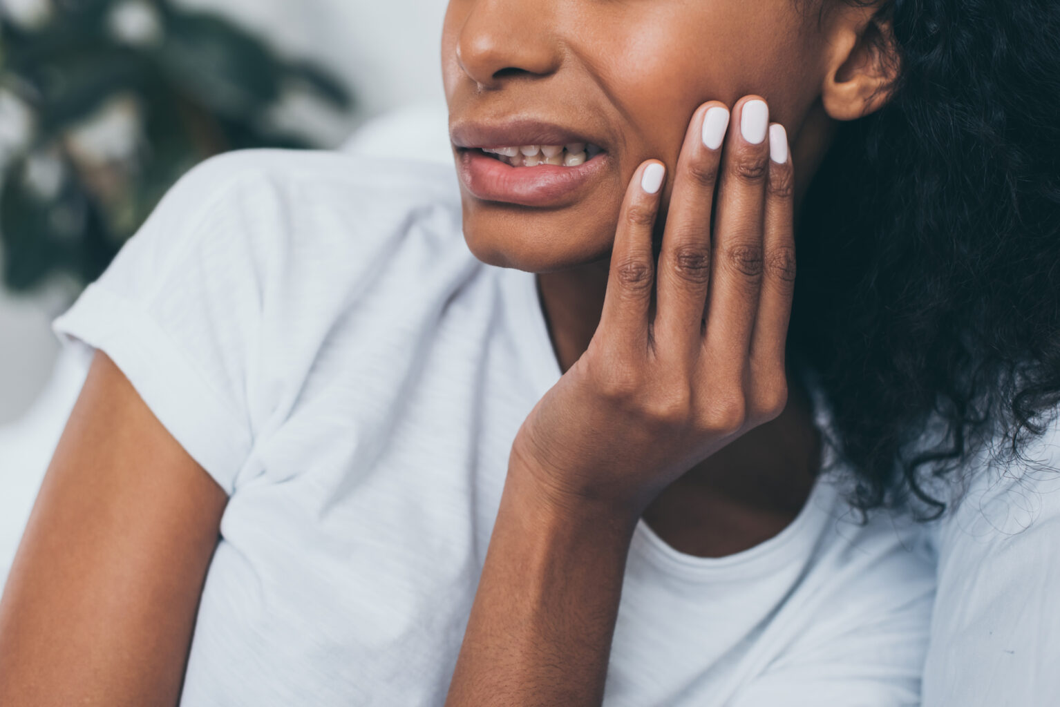 young woman suffering from TMJ disorder