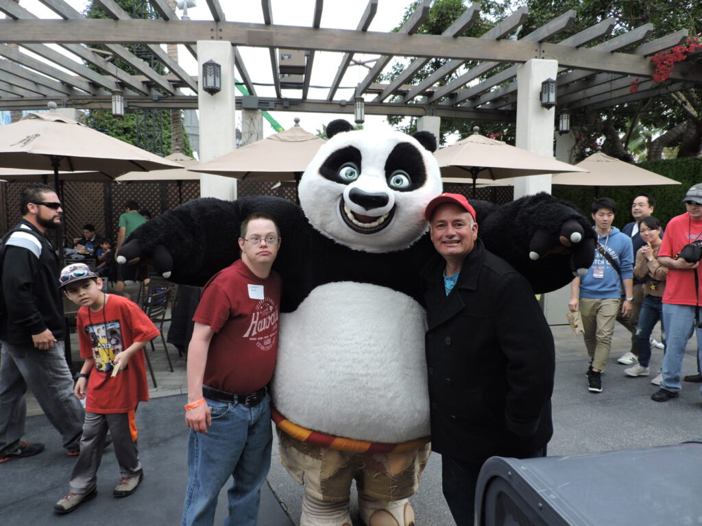 Two UCP Members posing with a character from Universal Studios