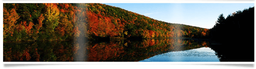 Decorative banner image of a lake in autumn.